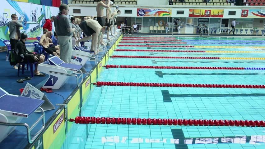 moscow apr 20 sportsmen jump into water during relay race of swimming in pool