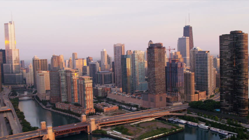 Aerial sunrise view downtown Chicago River skyscrapers, Trump Tower, marina district, Navy Pier, Chicago, Illinois, USA, shot on RED EPIC | Shutterstock HD Video #4249196