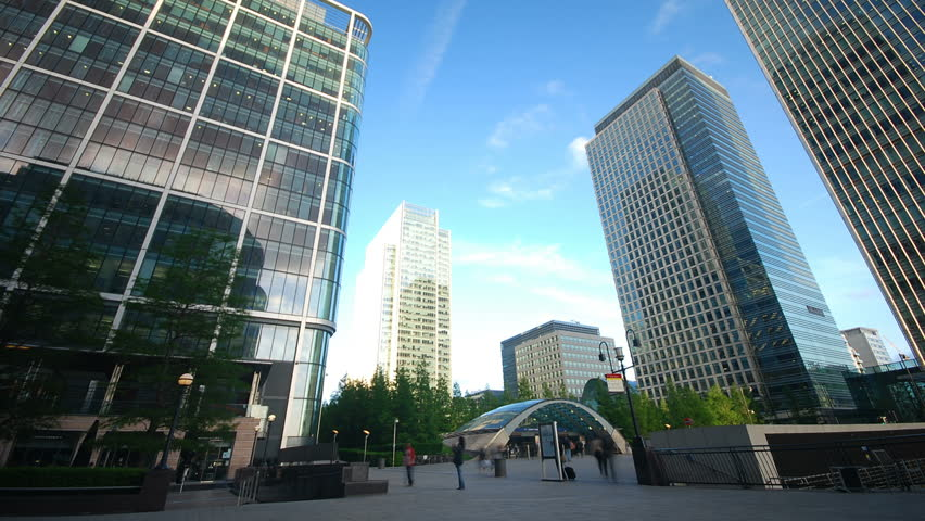 Time lapse of business people traveling in front of corporate office buildings and skyscrapers  at Canary Wharf in London