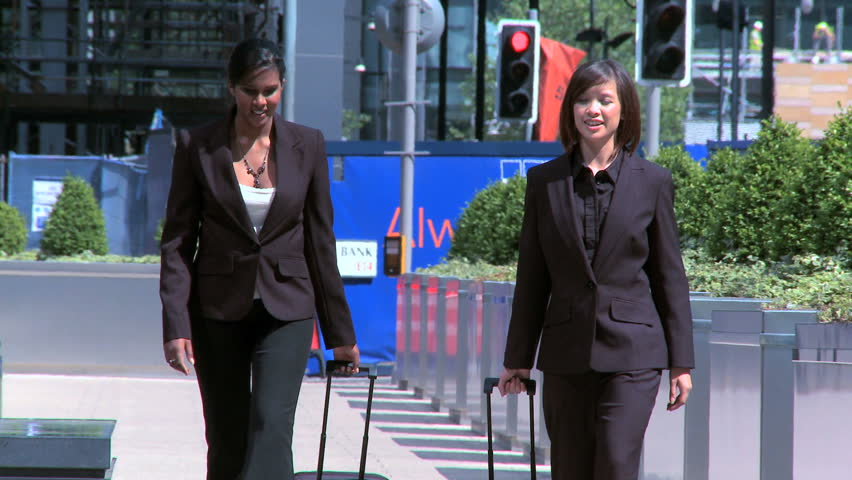 Smart city businesswomen preparing to travel from city airport