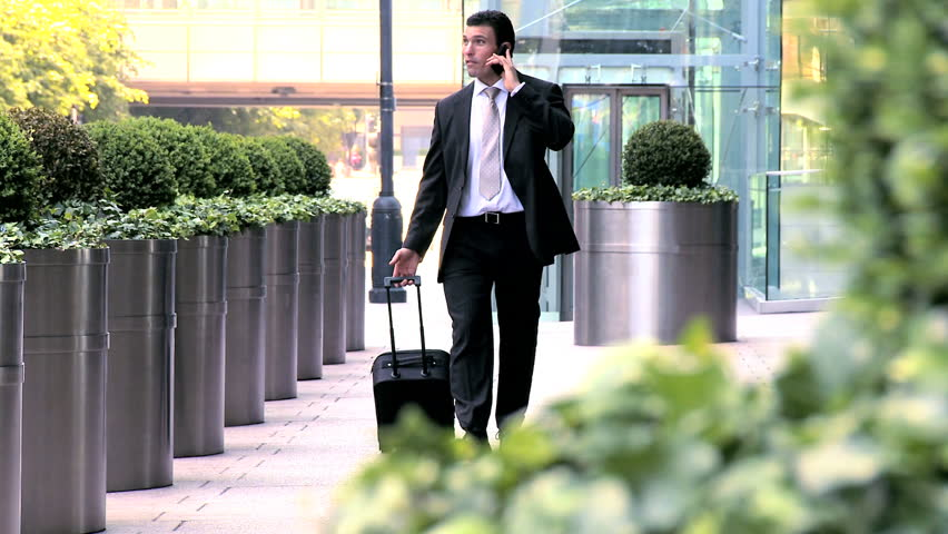 Young city businessman preparing to travel from city airport | Shutterstock HD Video #428656