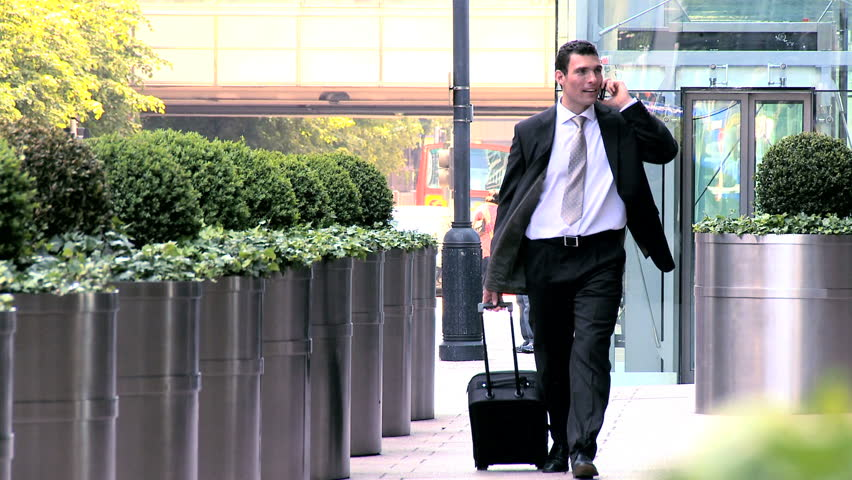 Young city businessman preparing to travel from city airport | Shutterstock HD Video #428677