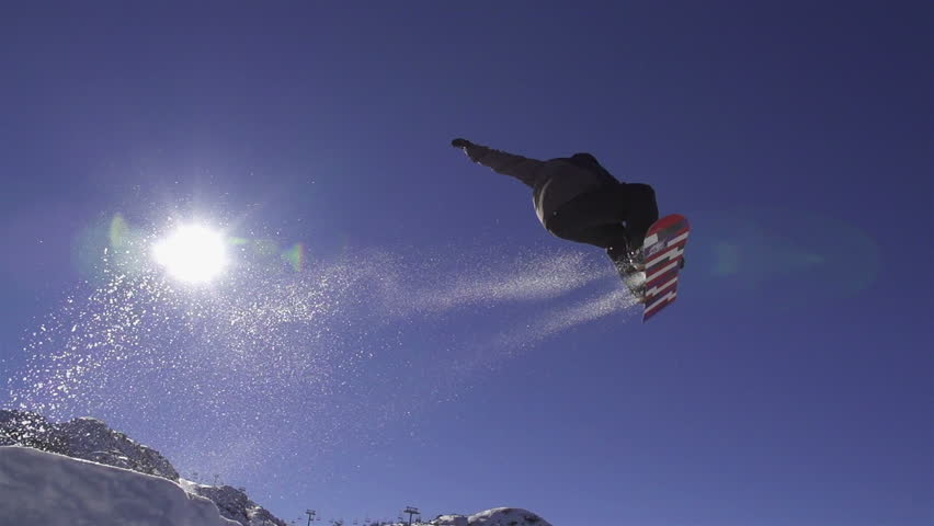 SLOW MOTION: Snowboarder jumping a kicker | Shutterstock HD Video #4334546