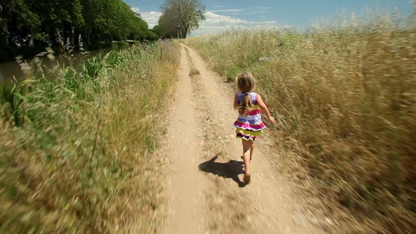 Little girl running along path track in nature. | Shutterstock HD Video #4341986