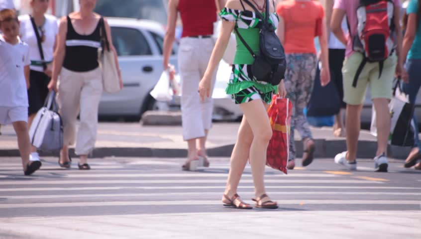 Hot sexy legs of young adult women walking down the street. Hot summer weather.    Shutterstock HD Video #4345196
