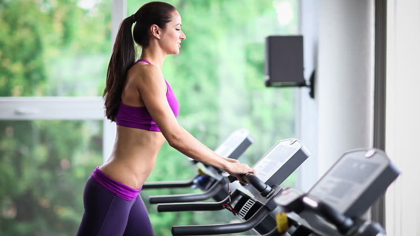 Woman running on treadmill slow motion