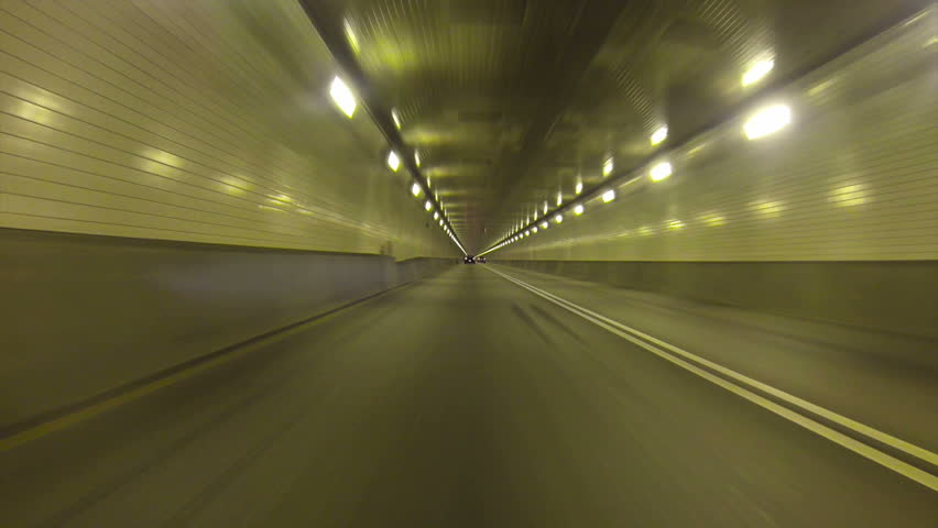 Low-angle perspective of driving inside the Fort Pitt Tunnels in Pittsburgh, Pennsylvania.