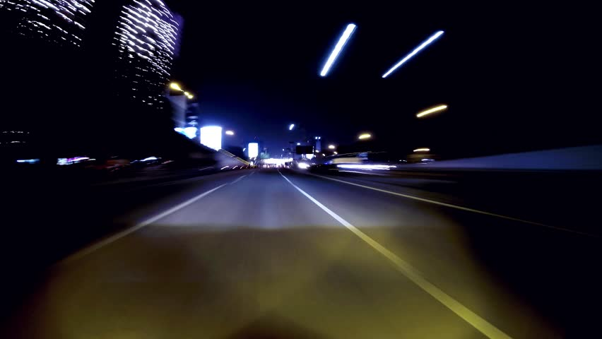 Seamless loop time lapse of car driving on highway at night. | Shutterstock HD Video #4384616