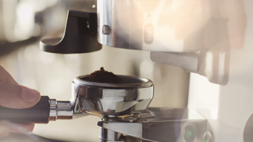 Making Ground Coffee with Coffee Grinder. Close-Up. Shot on RED Digital Cinema Camera in 4K (ultra-high definition (UHD)), so you can easily crop, rotate and zoom, without losing quality!