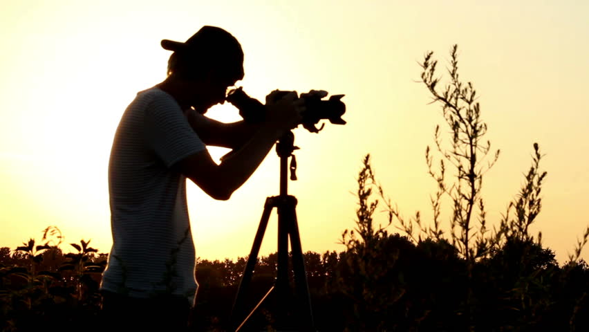 Image result for man shooting with a camera