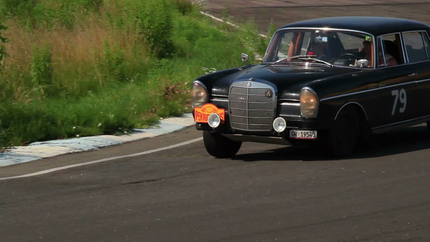 KIEV, UKRAINE - JUNE 22: International Rally Peking to Paris 2013. Black classic Mercedes Benz 300 SE turning on the road