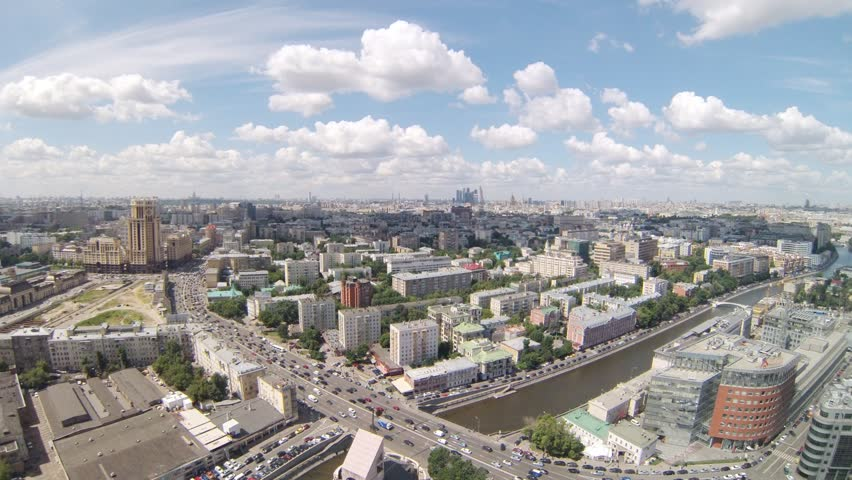 Beautiful aerial view of city with river during the day, timelapse