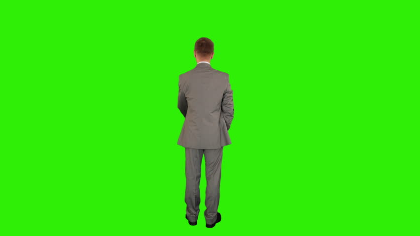 Young businessman opening umbrella, back view, Green Screen