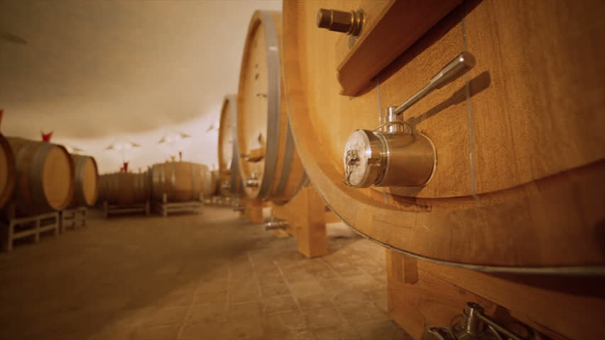 Detail of wine barrels in cellar of the winery. Slow motion