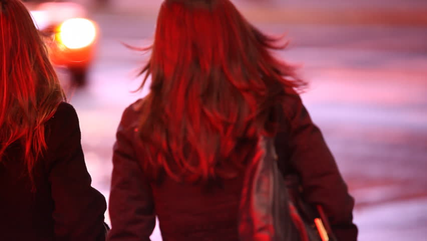 Two young women trying to hold a cab on Times Square Manhattan, New York City / HD1080 / 29.97fps