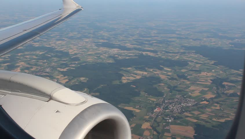 Passenger jet wing and engine seen through the airplane window during the flight at high altitude #4423556