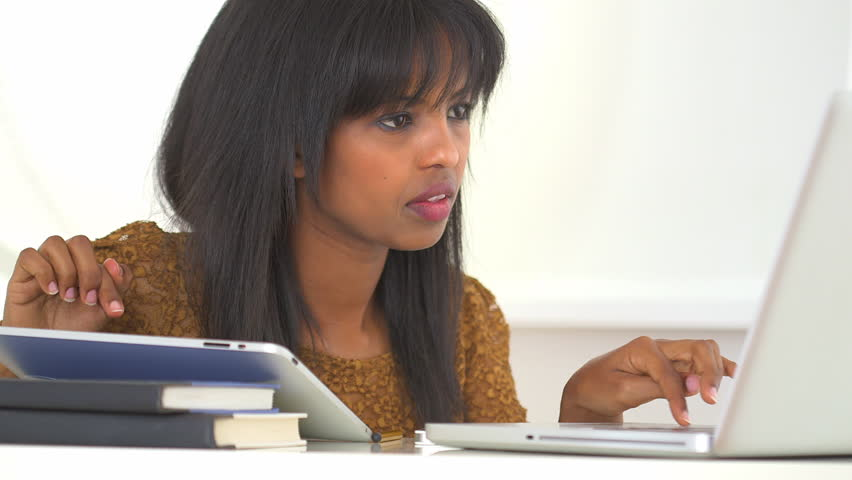 Black college student studying with new technology