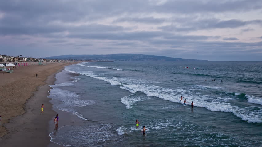 MANHATTAN BEACH - AUGUST 12: children playing in the ocean on August 12, 2013 in Manhattan Beach. Manhattan Beach is a beachfront city located in southwestern Los Angeles County, California, USA.