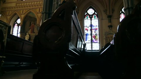 Interior dolly of old church pews.