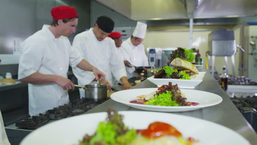 professional chefs in a restaurant or hotel kitchen. they are