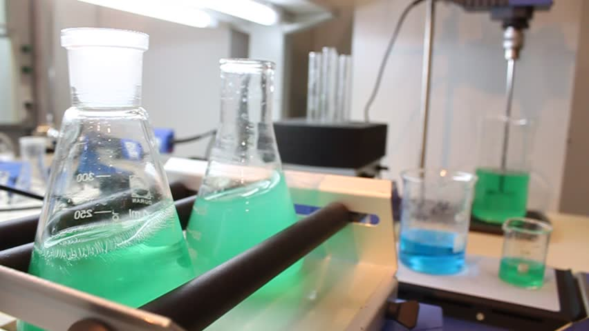 Medical laboratory. Flasks with green and blue liquids in chemical-analysis laboratory | Shutterstock HD Video #4479026