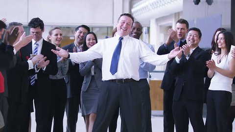 Successful Businessman with his entourage of staff. Politician and his public. A large group of business people in offices.