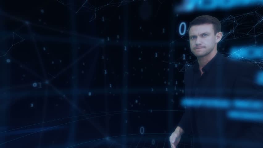 Touch screen interactivity. Businessman uses futuristic motion device to operate a powerful computer and imaging device. | Shutterstock HD Video #4483574