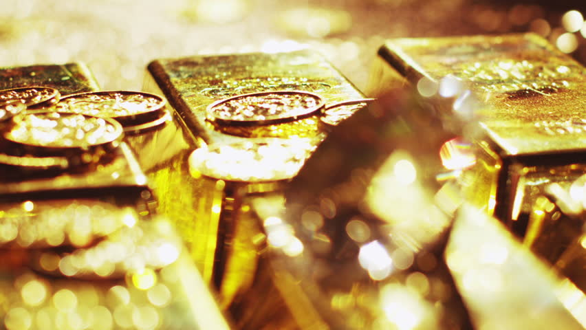 Gold bars, coins and riches. A scene of cluttered treasure and diamonds. Unimaginable wealth.