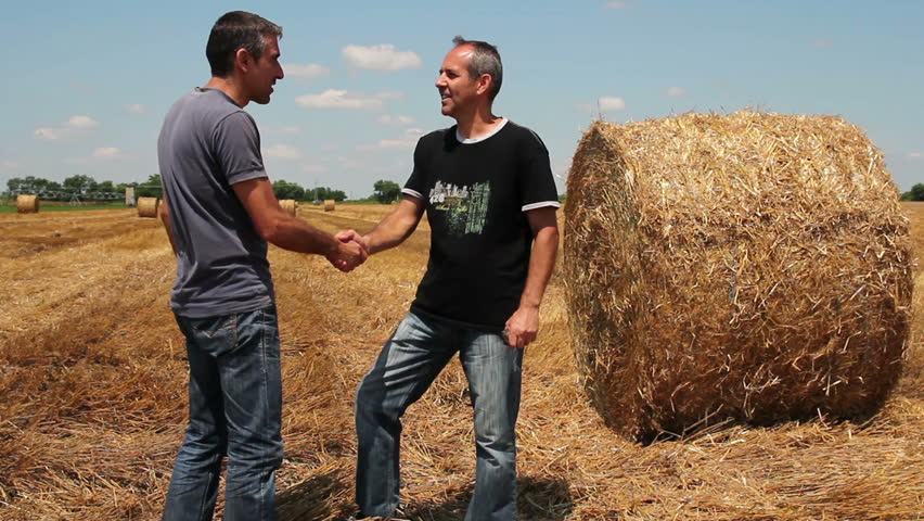Two Farmers Talking.Two farmers and hay bale on a summer stubble field after harvest . HD 1080p.  | Shutterstock HD Video #4497206