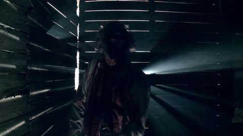 hungry undead zombie walks towards camera