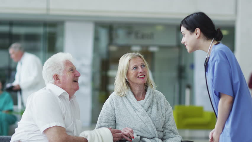 Woman comforted by caring medical staff. Assisting people when life throws unexpected obstacles in your way. A hospital ward or waiting area where patients can by seen by doctors and nursing staff. | Shutterstock HD Video #4503806