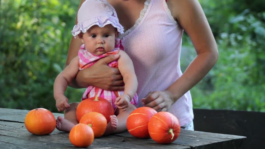 Mother and child playing with pumpkins | Shutterstock HD Video #4516526