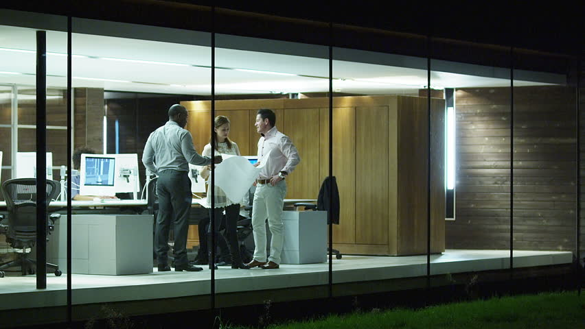 Contemporary small creative business working late through the night.  Casual young people in architecture company. | Shutterstock HD Video #4521788