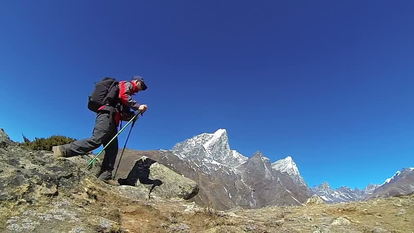 Male mountaineer on the top of world, Mount Everest,Himalayas. Slow motion,high speed camera.