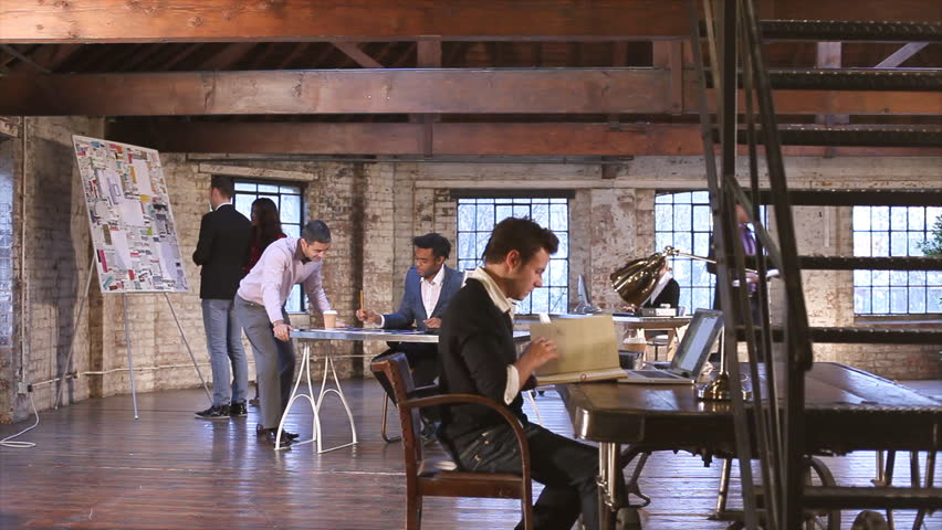 Small creative business and team working in casual chic downtown loft office.  | Shutterstock HD Video #4525376
