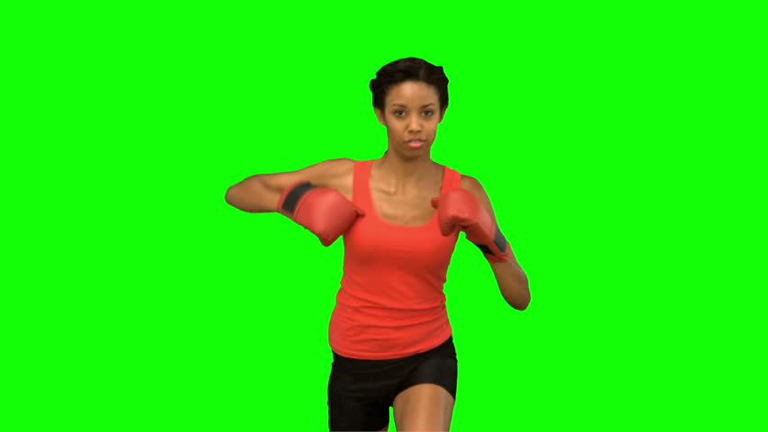 Woman boxing on green screen in slow motion