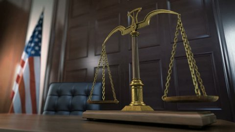 Balancing Scales of Justice in The Court. American Flag in The Background