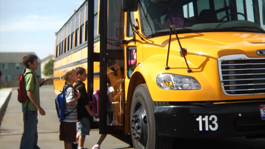 Students getting on school bus | Shutterstock HD Video #4541216