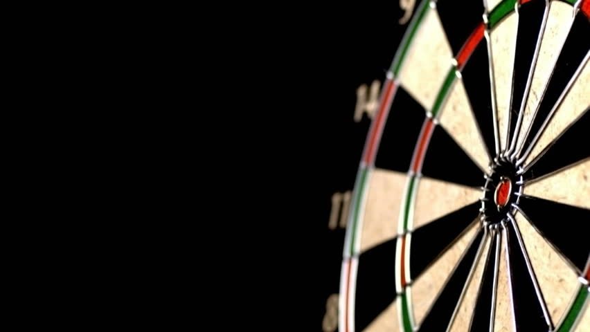 Dart hitting bull's eye, slow motion