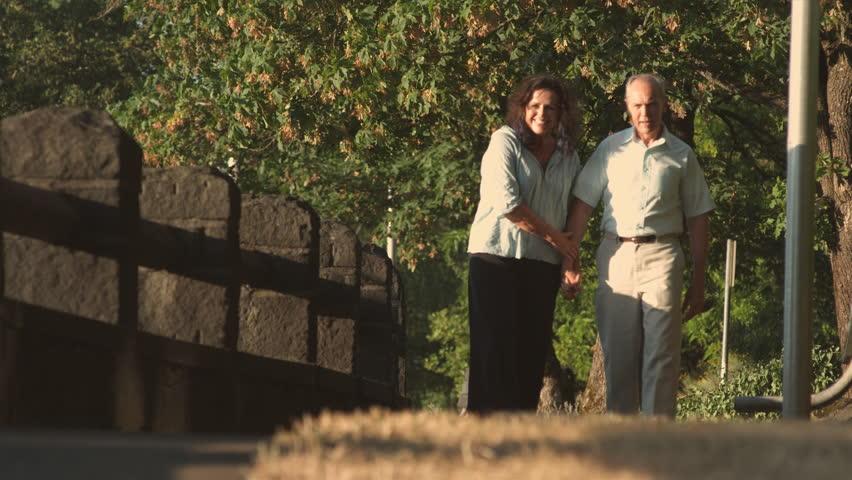 Mature Couple walks on park path | Shutterstock HD Video #4554716