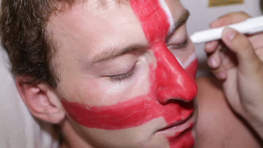 Man face painting flag of United Kingdom
