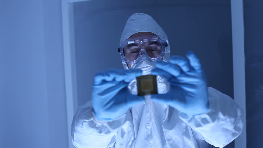 Man in clean room holds up computer cpu microchip | Shutterstock HD Video #4558376