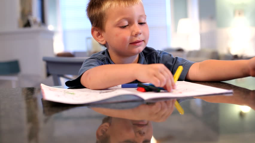 Stock Video Of Young Boy Coloring With Crayons