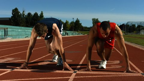 Track runners at starting line, slow motion