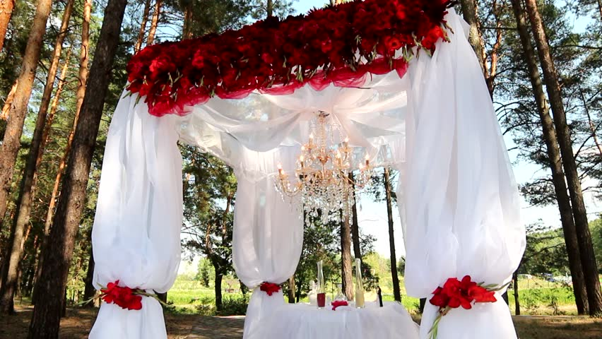 Outdoor wedding setting for celebration of becoming family outdoor wedding setting for celebration of becoming family wedding decorations details of decor floral compositions red flowers and beautiful arch junglespirit Gallery