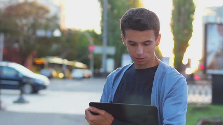 Male with tablet computer smiles, inspire ideas thinking looking