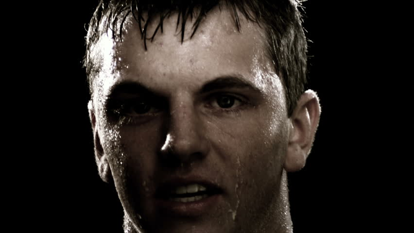 Close up of man running and sweating