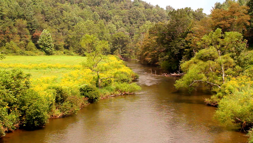 Free Flowers River Mountain: Tourists Standing On A Bridge Viewing The Linville River