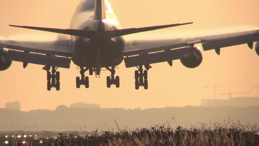 Big Jumbojet landing at sunrise