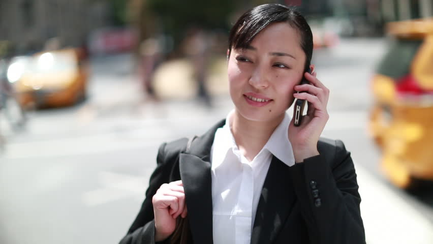 Asian business woman talking on a cellphone in New York City | Shutterstock HD Video #4638326